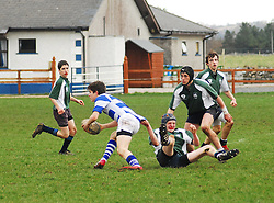 ' Got Ya ' Rice College's Eddie Dunning looks tetermined to get his man tackled against Garbally College in the Connacht Schools Junior Cup...Pic Conor McKeown