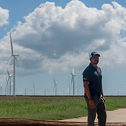 OCTOBER 13 - SANTA ISABEL, PUERTO RICO - <br /> Ruben Rivera, Facilities Manager for Pattern Energy, near the  wind turbines on a field near agriculture and farm animals in Santa Isabel after the path of  Hurricane Maria. Traditional wooden poles with power lines were felled by the hurricane.<br /> (Photo by Angel Valentin/Freelance)