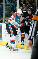 KELOWNA, CANADA, JANUARY 1: Mackenzie Johnston #22 of the Kelowna Rockets checks an opposing player into the boards as the Calgary Hitmen visit the Kelowna Rockets on January 1, 2012 at Prospera Place in Kelowna, British Columbia, Canada (Photo by Marissa Baecker/Getty Images) *** Local Caption ***