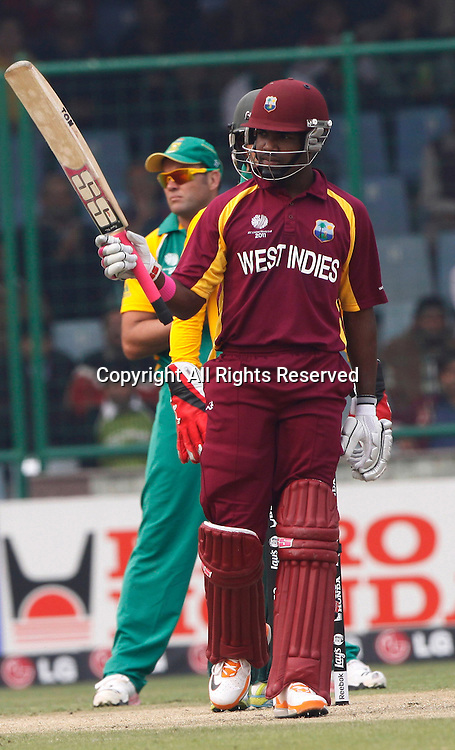 24.02.2011 Cricket World Cup from the Feroz Shah Kotla stadium in Delhi. South Africa v West Indies. Dwayne Bravo of West Indies celebrates his fifity during the match of the ICC Cricket World Cup between South Africa and West Indies.