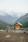 A man walks to his granary in chitkul village, Kinnaur. This small village gets cut off the world in the winters with heavy snowfall and the locals use these granaries to survive.