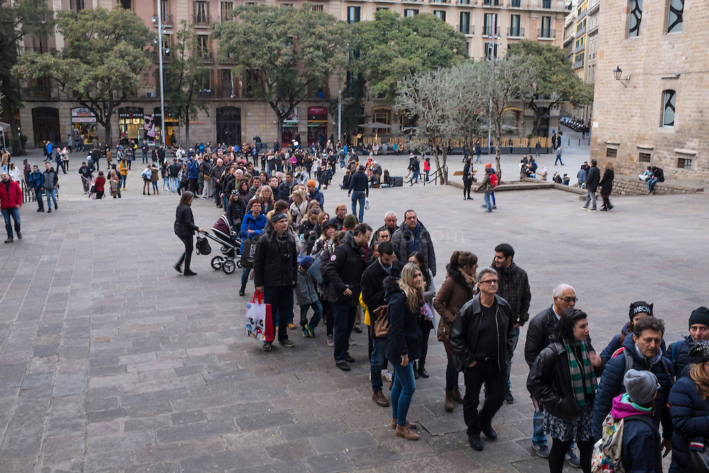 Tourists queing outside the Cathedral of Barcelona.
