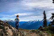 Syndey Kaufman looks at Mount Olympus and the Hoh river valley, during a backpacking trip in Olympic National Park, Washington, May. 31, 2015. (Photo by David Lienemann)
