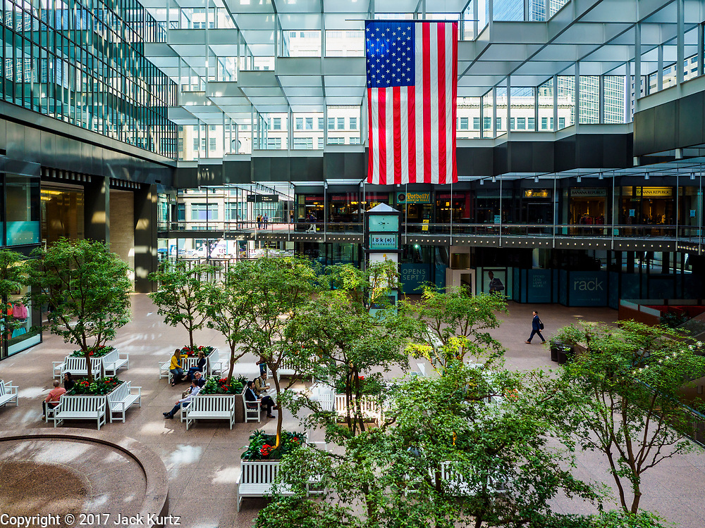 03 MAY 2017 - MINNEAPOLIS, MN: The IDS Center, the hub of the Minneapolis skyway system. The skyways are enclosed pedestrian overpasses that connect downtown buildings. The Minneapolis Skyway was started in the early 1960s as a response to covered shopping malls in the suburbs that were drawing shoppers out of the downtown area. The system grew sporadically until 1974, when the construction of the IDS Center and its center atrium, called the Crystal Court, served as a hub for the downtown skyway system. There are 8 miles of skyways, connecting most of the downtown buildings from Target Field (home of the Minnesota Twins) to US Bank Stadium (home of the Minnesota Vikings). In the last five years many upscale downtown apartment buildings and condominium developments have been added to the system, allowing downtown residents to live and work downtown without going outside.     PHOTO BY JACK KURTZ