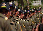 """Community Police members prepare to parade in the town of San Luis Acatlán, Guerrero on October 10th, 2010. The Community Police was born on October 1995, as result of ungovernability and violence in the municipalities of La Montaña and Costa Chica, and is formed by nahua, na'savi, me'phaa indigenous and mestizo people armed with precarious resources. In 1998, is consolidated the Regional Coordinator or Community Authorities (CRAC), civil organization responsible for the administration and justice. Instead of using jails, they practice a """"reeducation"""" system, for the offender reentry in community life. (Photo: Prometeo Lucero)"""