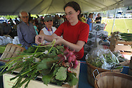 Kelly Marcy helps customers at the Oxford City Market on West Oxford Loop in Oxford, Miss. on Tuesday, May 14, 2013.