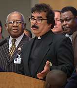 Hispanic Ministers Against Crime representative Pastor Agustin Guzman comments during a press conference for Project Safe Start, a collaborative program between area ministers, law enforcement and school officials to encourage students to have a safe summer, May 27, 2014.