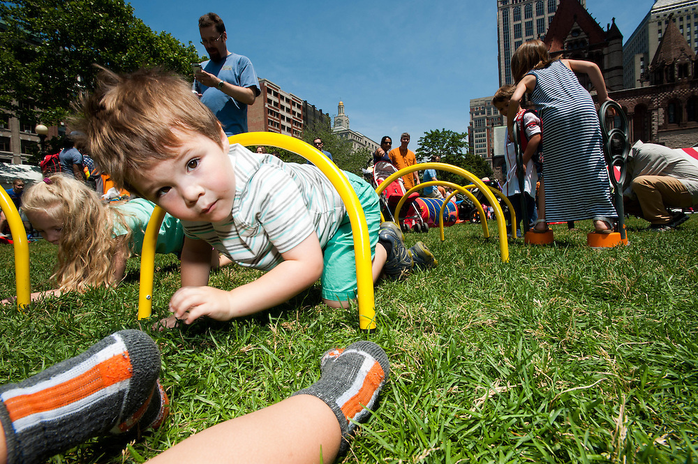 Kids play on the Copley Lawn during the Hubbub Festival.