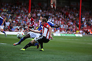 Alan Judge crossing ball to create a good chance for Ramallo Jota during the Sky Bet Championship match between Brentford and Ipswich Town at Griffin Park, London, England on 8 August 2015. Photo by Matthew Redman.