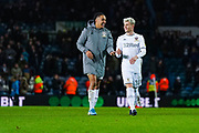 Leeds United forward Helder Costa (17) and Leeds United defender Gjanni Alioski (10) reacts after winning 2-0 during the EFL Sky Bet Championship match between Leeds United and Hull City at Elland Road, Leeds, England on 10 December 2019.