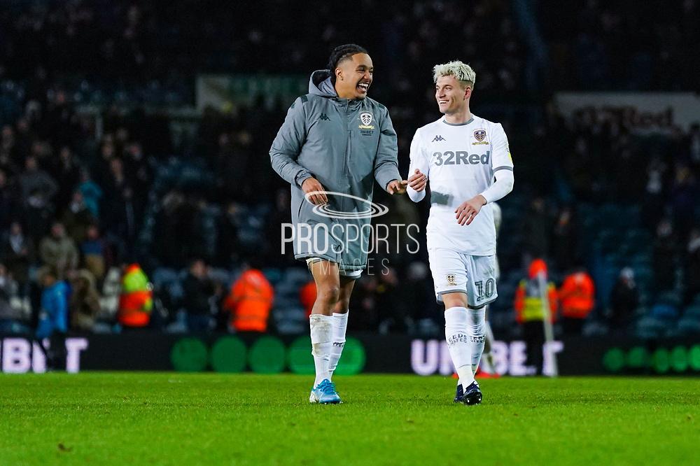 Leeds United forward Helder Costa (17) and Leeds United defender Gjanni Alioski (10) reacts after winning 2-0 during the EFL Sky Bet Championship match between Leeds United and Hull City at Elland Road, Leeds, England on 10 December 2019.