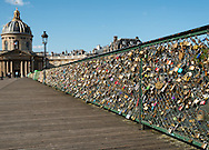 Couples leave locks on a bridge over the Seine River.