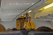 Cabin crew demonstrates safety procedures inside the cabin of a Travel Service Airlines (Czech Republic) Boeing 737-800