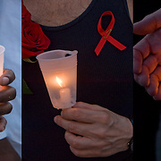 AIDS Candlelight Vigil, remembrance  and memorial of love ones who died of HIV/AIDS and a show of support for survivors and those now afflicted.  A show of  emotions of grief and sorrow. <br /> AIDS Candlelight Vigil - GOR-75188-10<br /> AIDS Candlelight Vigil - GOR-75182-10<br /> AIDS Candlelight Vigil - GOR-75195-10