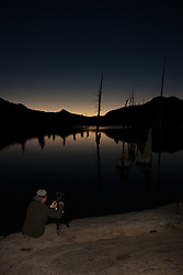"""Photographer at Lake Aloha"" - Photograph of a Tony Spiker of www.SpikerPhotgraphy.com photographing sunset at Lake Aloha in the Tahoe Desolation Wilderness."