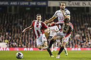 Andros Townsend of Tottenham Hotspur (2nd right) is shut out by Bob Harris of Sheffield United during the Capital One Cup Semi-Final 1st Leg match between Tottenham Hotspur and Sheffield Utd at White Hart Lane, London, England on 21 January 2015. Photo by David Horn.