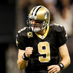 December 4, 2011; New Orleans, LA, USA; New Orleans Saints quarterback Drew Brees (9) celebrates a touchdown against the Detroit Lions during a game at the Mercedes-Benz Superdome. The Saints defeated the Lions 31-17. Mandatory Credit: Derick E. Hingle-US PRESSWIRE