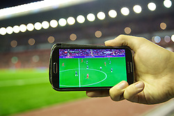 LIVERPOOL, ENGLAND - Tuesday, August 27, 2013: Live streaming of the game via Sky Sports Mobile App on a Samsung smartphone as Liverpool take on Notts County during the Football League Cup 2nd Round match at Anfield. (Pic by David Rawcliffe/Propaganda)