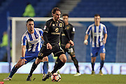 Milton Keynes Dons midfielder Edward Upson (6) and Brighton & Hove Albion central midfielder Beram Kayal (7) during the The FA Cup match between Brighton and Hove Albion and Milton Keynes Dons at the American Express Community Stadium, Brighton and Hove, England on 7 January 2017.