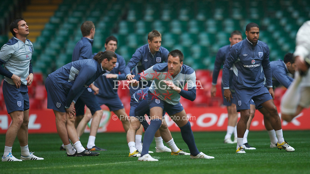 CARDIFF, WALES - Friday, March 25, 2011: England's captain John Terry during a training session at the Millennium Stadium ahead of the UEFA Euro 2012 qualifying Group G match against England. (Photo by David Rawcliffe/Propaganda)