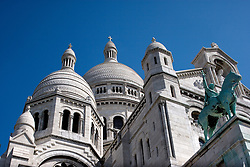 Sacré Coeur, the Basilica of the Sacred Heart, is at the top of Montmartre, the highest point in Paris