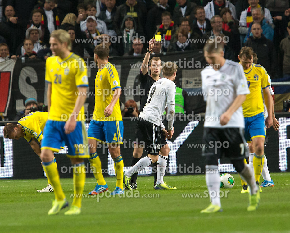 15.10.2013, Friends Arena, Stockholm, SWE, FIFA WM Qualifikation, Schweden vs Deutschland, Gruppe C, im Bild Germany 9 Andre Schürrle Schurrle varning gult kort warning yellow card,, , Nyckelord , Keywords : football , fotboll , soccer , FIFA , World Cup , Qualification , Sweden , Sverige , Schweden , Germany , Tyskland , Deutschland // during the FIFA World Cup Qualifier Group C Match between Sweden and Germany at the Friends Arena, Stockholm, Sweden on 2013/10/15. EXPA Pictures © 2013, PhotoCredit: EXPA/ PicAgency Skycam/ Ted Malm<br /> <br /> ***** ATTENTION - OUT OF SWE *****