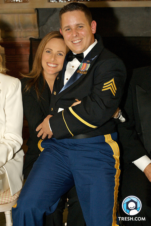 "Former U.S. Army Sergeant Bleu Copas sitting on the lap of ""The L Word"" acress Marlee Matlin prior to the Servicemembers Legal Defense Network 15th Annual Dinner, held Saturday, March 24, 2007, at the National Building Museum in Washington, D.C."
