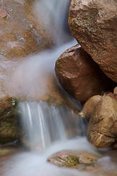 The Virgin River flows over a small group of rocks in Zion National Park, Utah.