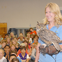 SeaWorld Animal Ambassador Melanie Angeles shows an Great Horned Owl to a group of second grade students at Franklin Elementary School on Thursday, June 9, 2011.