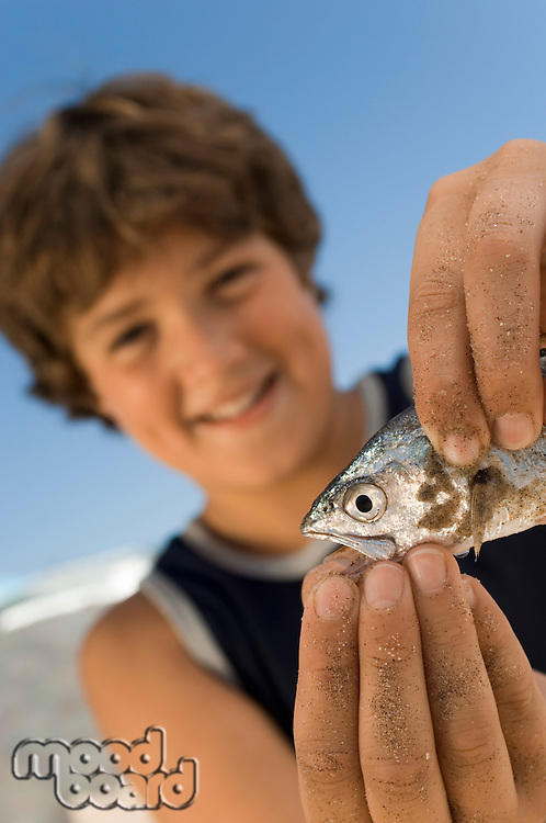 Boy Playing with Fish