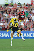 10.03.2013 Sydney, Australia. Wanderers midfielder Aaron Mooy and Wellingtons Spanish midfielder Dani S·nchez  in action during the A League game between Western Sydney Wanderers and Wellington Phoenix FC from the Parramatta Stadium. The Wanderers won 2-1.