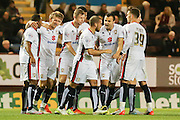 MK Dons celebrate Milton Keynes Dons midfielder Carl Baker equaliser  during the Sky Bet Championship match between Burnley and Milton Keynes Dons at Turf Moor, Burnley, England on 15 September 2015. Photo by Simon Davies.