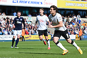 Chris Martin watches his penalty hit the net to pull one back and make it 3-2 to Millwall during the Sky Bet Championship match between Millwall and Derby County at The Den, London, England on 25 April 2015. Photo by David Charbit.