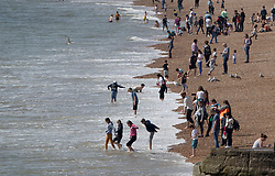 © Licensed to London News Pictures. 18/04/2019. Brighton, UK. Crowds flock to the beach in Brighton. High temperatures and sunshine are expected in parts of the United Kingdom over the next few days leading to the Easter Weekend. Photo credit: Peter Macdiarmid/LNP