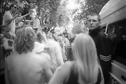 Police man among ravers demonstrating at the 2nd Criminal Justice March, Victoria, London, UK, 23rd of July 1994.