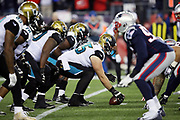 The Jacksonville Jaguars offensive line gets set at the line of scrimmage opposite the New England Patriots defensive line during the AFC Championship NFL playoff football game against the New England Patriots, Sunday, Jan. 21, 2018 in Foxborough, Mass. The Patriots won the game 24-20. (©Paul Anthony Spinelli)