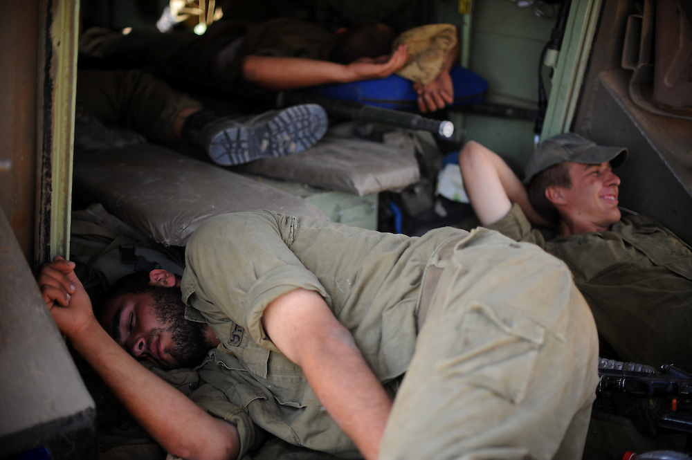UNSPECIFIED, ISRAEL - JULY 19, 2014: Israeli soldiers sleep inside an APC in an army deployment area near Israel's border with the Gaza Strip, on July 19, 2014,  on the second day of Israeli ground invasion into Gaza Strip in order to destroy terror tunnels infrastructure. Photo by Gili Yaari
