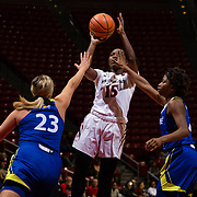 24 February 2018: The San Diego State women's basketball team closes out it's home schedule of the regular season Saturday afternoon against San Jose State. San Diego State Aztecs guard McKynzie Fort (15) attempts a shot while being defended by two Spartans in the first quarter. At halftime the Aztecs lead the Spartans 36-33 at Viejas Arena.<br /> More game action at sdsuaztecphotos.com