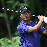 K.J. Choi, South Korea, in action during the first round of the Travelers Championship at the TPC River Highlands, Cromwell, Connecticut, USA. 19th June 2014. Photo Tim Clayton