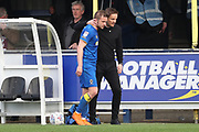 AFC Wimbledon manager Neal Ardley talking to AFC Wimbledon midfielder Dean Parrett (18) after being subbed during the EFL Sky Bet League 1 match between AFC Wimbledon and Scunthorpe United at the Cherry Red Records Stadium, Kingston, England on 7 April 2018. Picture by Matthew Redman.