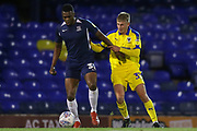 AFC Wimbledon defender Jack Madelin (31) challenging Southend United forward Emile Acquah (32) during the EFL Trophy match between Southend United and AFC Wimbledon at Roots Hall, Southend, England on 13 November 2019.