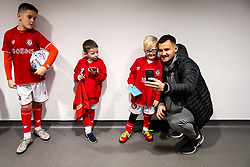 Bailey Wright of Bristol City as mascots meet the players - Rogan/JMP - 10/12/2019 - Ashton Gate Stadium - Bristol, England - Bristol City v Milwall FC - Sky Bet Championship.