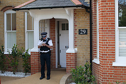 Three children found dead in south London house. Police officer stands in front of the house where three children were found Tuesday night. Thetford Road, New Malden, South London, London, United Kingdom. Wednesday, 23rd April 2014. Picture by Daniel Leal-Olivas / i-Images