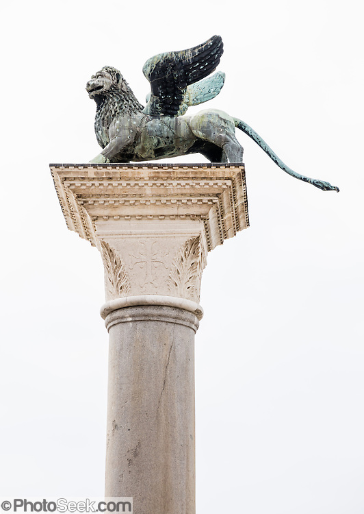 Statue Of Winged Lion Of St Mark Symbol Of Venice In Piazzetta
