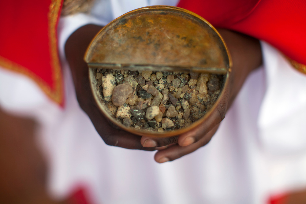 An altar server holds a bowl of incense at the Shrine of Our Lady of Sorrows in Kibeho, Rwanda. This is the only sanctioned Marian sanctuary in Africa. Kibeho's overseers and the Rwandan government hope this place will become a top tourism site. The Virgin Mary appeared here in 1981to three young women, one of whom still lives near the church grounds.<br /> <br /> Photographed on Sunday, October 26, 2014.<br /> <br /> Photo by Laura Elizabeth Pohl