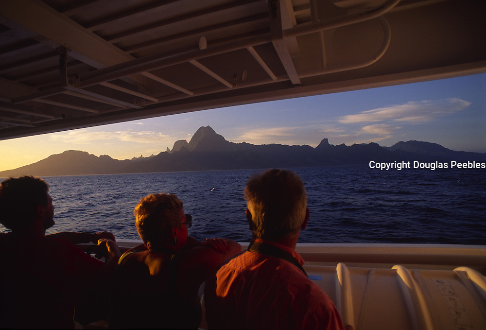 Boat off Moorea at sunset, French Polynesia<br />