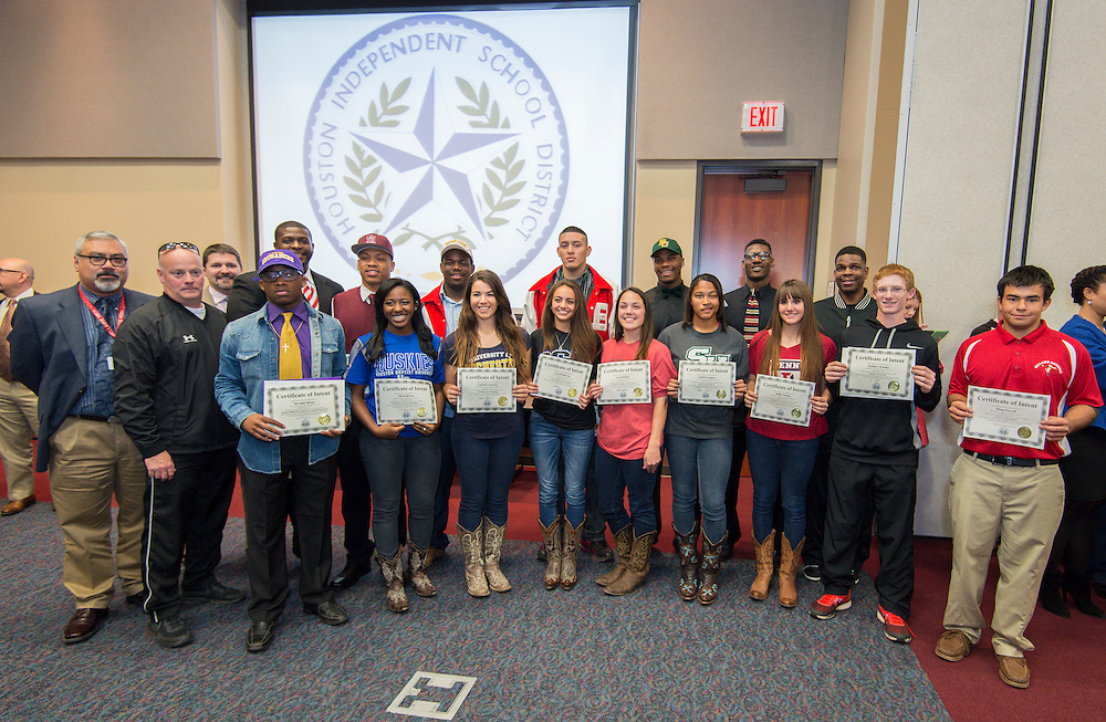 Bellaire student athletes pose for a photograph during a National Signing Day ceremony at the Region 4 Education Center, February 5, 2014.