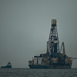 Transocean's Discoverer Enterprise drill ship leased by BP Plc is offline as BP tests a new containment cap at the source of the BP Plc Deep Water Horizon oil spill site in the Gulf of Mexico  off the coast of Louisiana, U.S., on Thursday, July 15, 2010. Photographer: Derick E. Hingle/Bloomberg