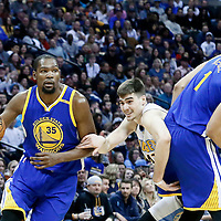 13 February 2017: Golden State Warriors forward Kevin Durant (35) drives past Denver Nuggets forward Juancho Hernangomez (41) on a screen set by Golden State Warriors center JaVale McGee (1) during the Denver Nuggets 132-110 victory over the Golden State Warriors, at the Pepsi Center, Denver, Colorado, USA.