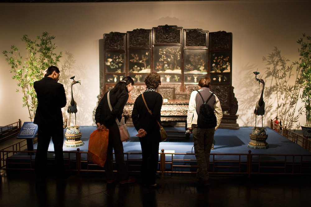Visitors look at Qing Dynasty furniture on display in the Shanghai Museum, China